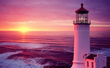 inspiring light house at sunset image