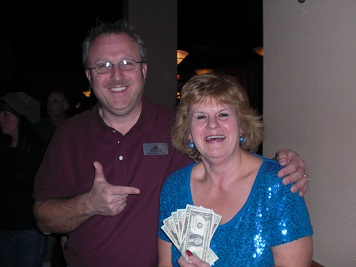 50/50 winner with Alumni Association Predident Dennis Grant at the Fundraiser at the Eagles Lodge with the Rhythm Dawgs