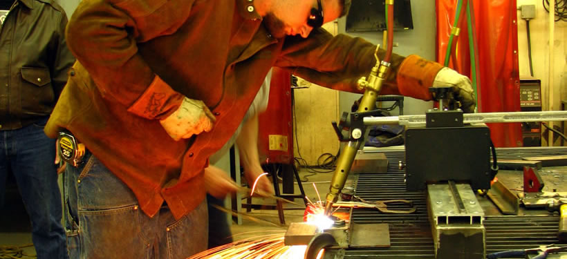 students using larger welding tools
