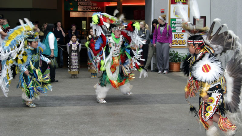 members of the Coeur d'Alene tribe dancing