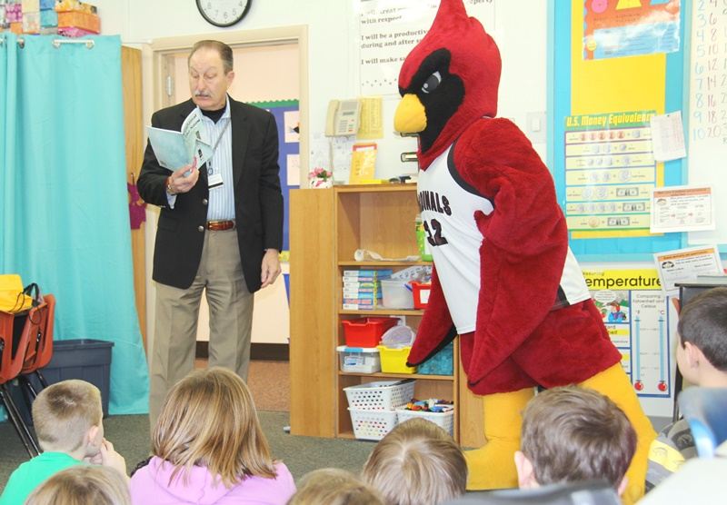 Cecil and Joe reading to students