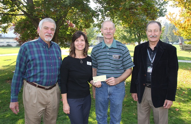 Pictured, from left, are Kootenai Charities member John Goedde, NIC Foundation Executive Director Rayelle Anderson, founding member of Kootenai Charities Craig Frei, and NIC President Joe Dunlap.