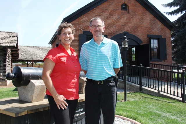 Rhonda Smalley and Mike Halpern in front of the the Powder Magazine
