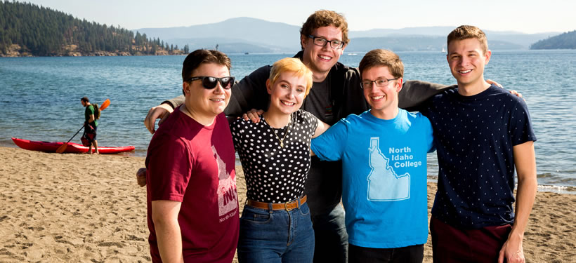 Smiling students by Lake Coeur d'Alene