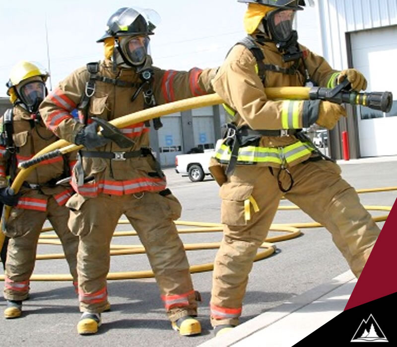 Firefighters holding firehose